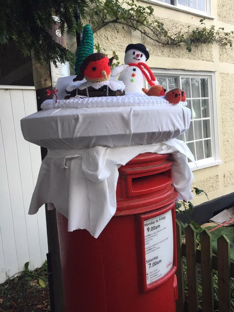 Christmas scenes on Church End postbox